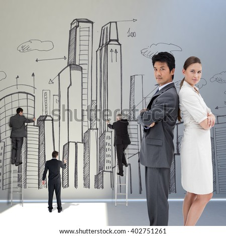 Portrait of business people standing back-to-back against white background with spotlight - stock photo
