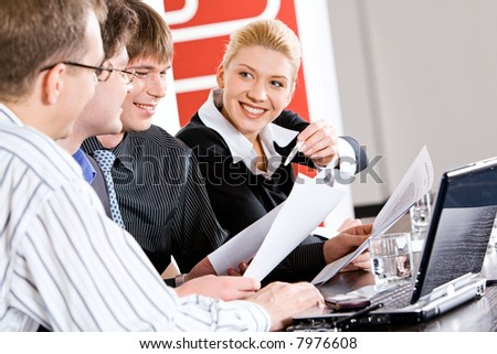 Portrait of business people working together at meeting