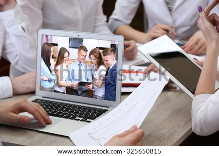 Portrait of business peoples attending video conference - stock photo