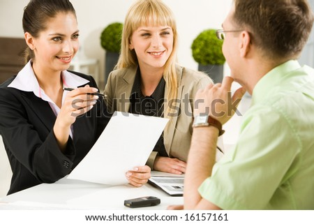 Portrait of business team communicating at meeting in the office - stock photo