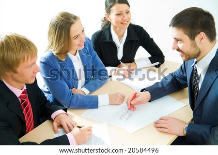 Portrait of business team discussing new plan - stock photo