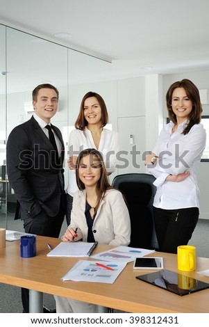Portrait of business team in the office. - stock photo