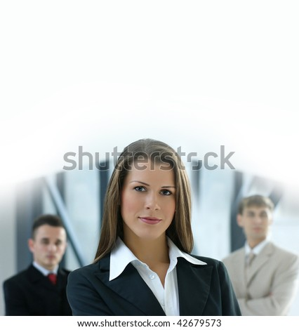 Portrait of business team over modern background - stock photo