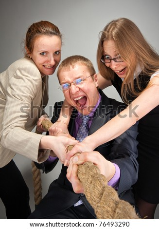 Portrait of business team pulling a rope