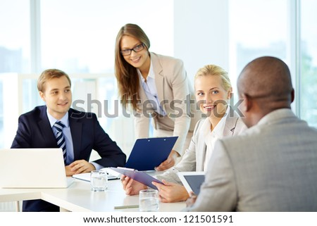 Portrait of business team working at meeting