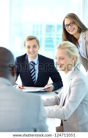 Portrait of business team working at meeting - stock photo