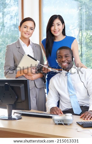 Portrait Of Business Team Working In Office