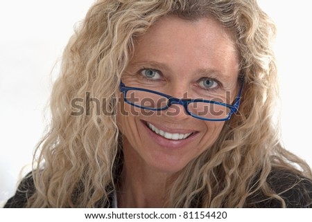 Portrait of business woman head shot with blue glasses and bright smile - stock photo