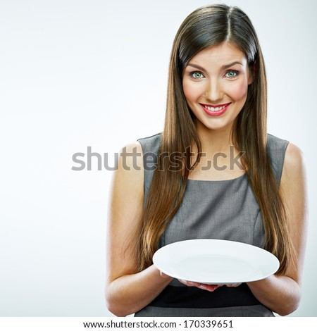 portrait of business woman hold empty white plate. Business concept portrait. - stock photo