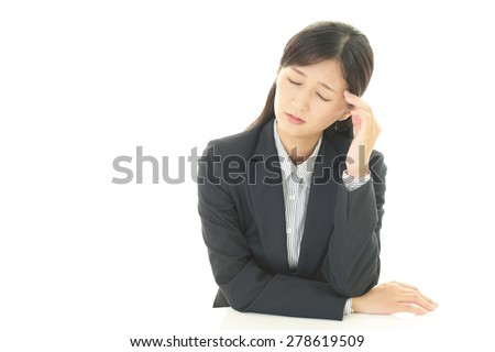 Portrait of business woman looking uneasy. - stock photo