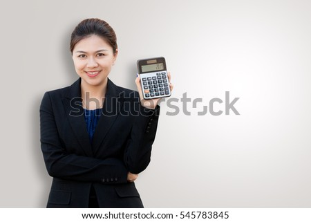 Portrait of business woman show calculator on color background with copy space