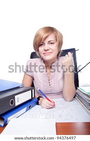 Portrait of business woman sitting at a desk in the office