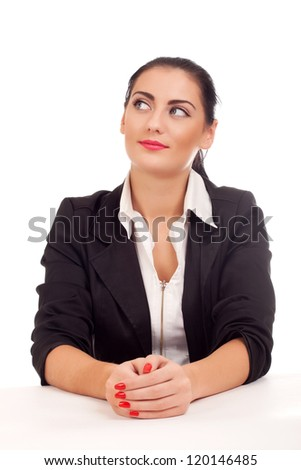 Portrait of business woman sitting on her desk - stock photo