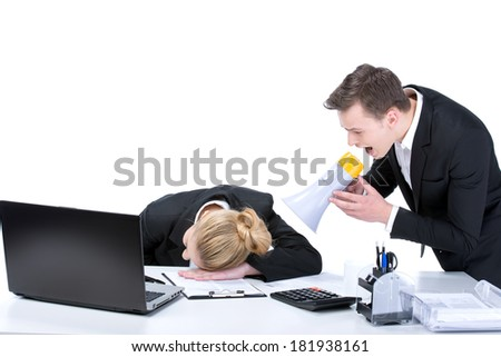 Portrait of business woman sleeping at workplace with businesswoman over waking him up, isolated on white - stock photo