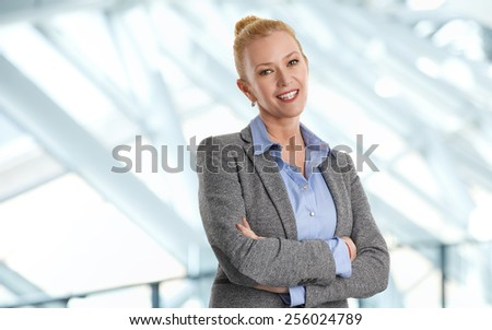 Portrait of business woman standing at office.  - stock photo