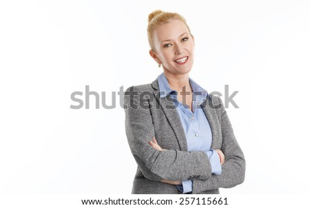 Portrait of business woman standing with arms crossed. Isolated on white background. - stock photo
