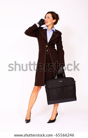 Portrait of business woman talking on the cell phone - stock photo