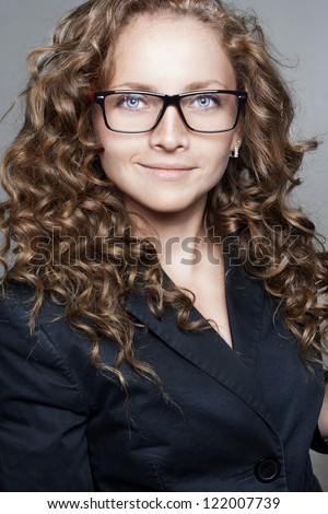 Portrait of business woman wearing glasses - stock photo