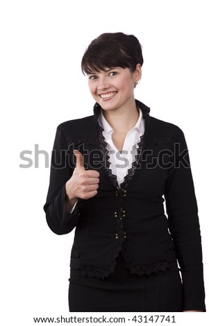 Portrait of business woman with brown hair is standing showing thumbs up.  Brunette businesswoman dressed in black suit giving an ok gesture with her forward hand. Isolated over white background.
