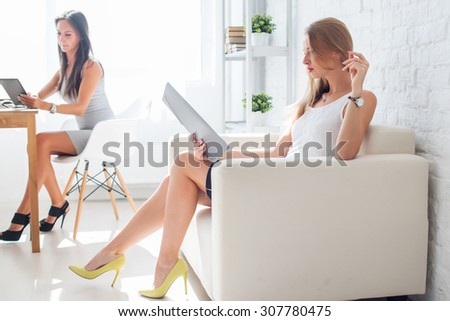 portrait of business woman with folder sitting at office on sofa. - stock photo
