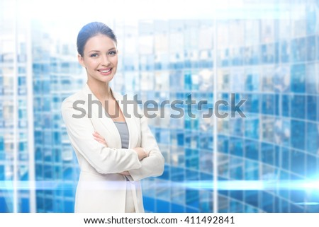 Portrait of business woman with hands crossed, modern blue background. Concept of leadership and success - stock photo