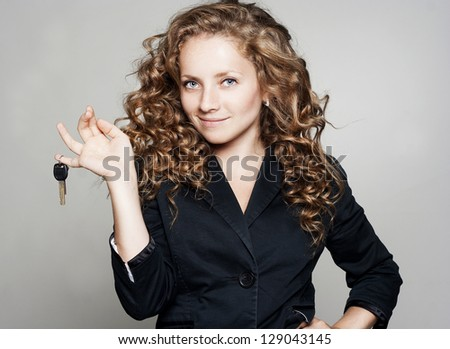 Portrait of business woman with keys