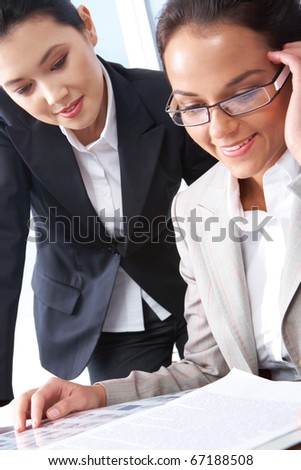 Portrait of business women discussing a working plan
