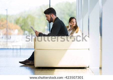 Portrait of business young people working with mobile phone in modern office. - stock photo