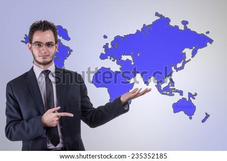 Portrait of businessman, background world map - stock photo