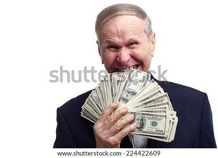 Portrait Of Businessman biting cash. Greedy mature man biting dollar bills with his teeth  isolated on white.  - stock photo