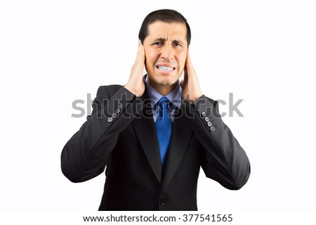 Portrait of businessman covering his ears with hand to not hear the great noise on white background - stock photo