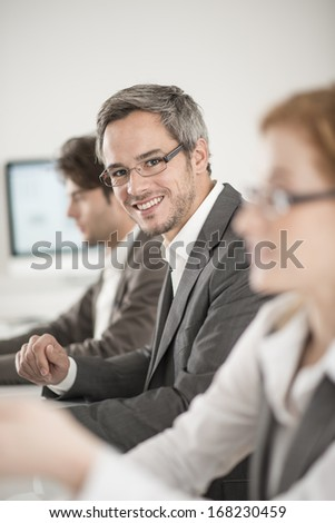 portrait of businessman during a meeting