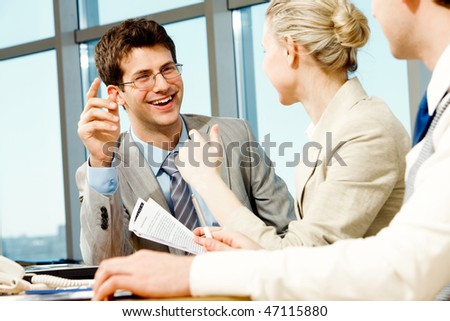 Portrait of businessman explaining work to his colleagues - stock photo