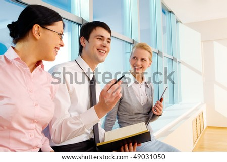 Portrait of businessman explaining work to his colleagues