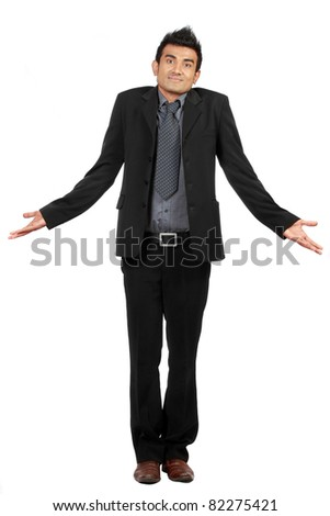 Portrait of businessman gesturing do not know sign against white background - stock photo