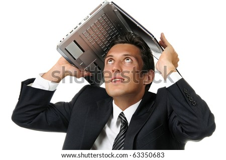 Portrait of businessman holding a laptop above his head. Isolated on white