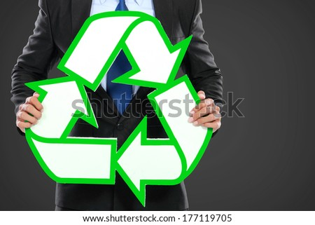 Portrait of businessman holding recycle sign icon - stock photo