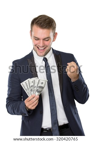 portrait of Businessman holding some money, smiling, one hand make a fist satisfied gesture. isolated over white background - stock photo