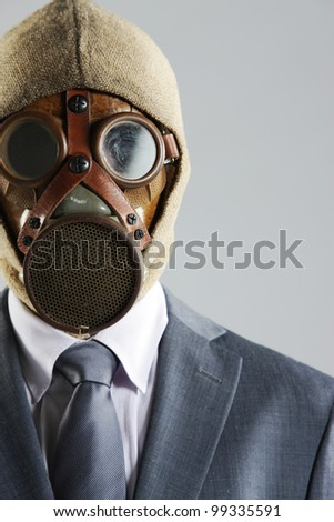 portrait of businessman in a gas mask