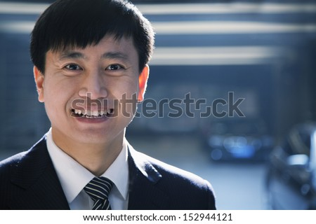 Portrait of businessman in a parking garage - stock photo