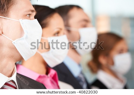 Portrait of businessman in protective mask with line of people on background - stock photo