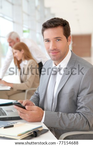 Portrait of businessman in the office - stock photo