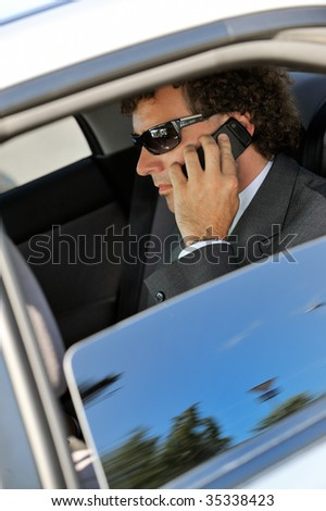 Portrait of businessman inside the car - stock photo