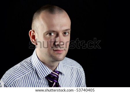 Portrait of businessman on a black background