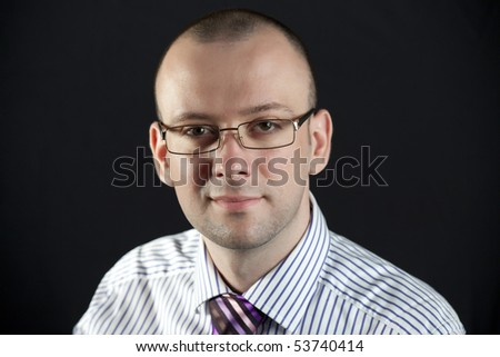 Portrait of businessman on a black background - stock photo