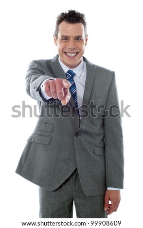 Portrait of businessman pointing at you isolated over white background - stock photo