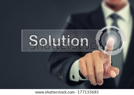portrait of Businessman push to  Solution button on virtual screen - stock photo