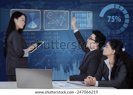 Portrait of businessman raise hand to ask at his leader in a business meeting - stock photo