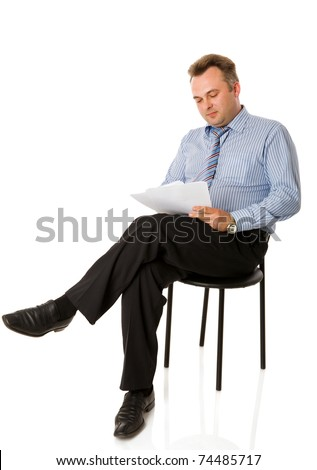 Portrait of Businessman reading papers isolated on white - stock photo