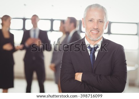 Portrait of businessman smiling at camera in the office - stock photo